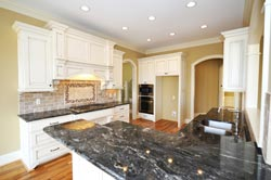 Black Granite kitchen white cabinets - Pleasantville Academy Marble and Granite