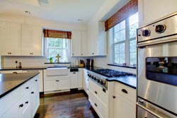 black granite white cabinets Granite kitchen - Pleasantville Academy Marble and Granite