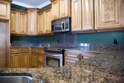 brown Granite kitchen - Pleasantville Academy Marble and Granite
